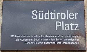 History of South Tyrol - Street sign in Innsbruck, North Tyrol, commemorating the separation of South Tyrol, set up in 1923 in response to the prohibition of the original southern Tyrolean place names