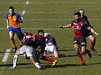 ST vs SUA - 2012-02-18 - Match - 32bis - Nyanga avoiding tackle.jpg