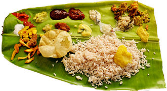 Cuisine of Kerala - A typical sadya, where banana leaves are used as plates