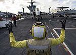 Sailor directs an F-A-18F Super Hornet on the flight deck of the USS Dwight D. Eisenhower. (26276337532).jpg