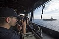 Sailor takes ranges in the pilot house of USS Shiloh. (27794179785).jpg