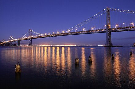 The Bay Bridge offers the only direct automobile connection to the East Bay San Francisco Oakland Bay Bridge at night.jpg