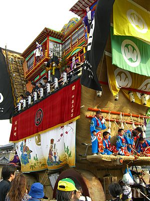 Nanao, Ishikawa - The Dekayama, a large mikoshi on wheels, passing through the crowd at the Seihakusai matsuri of Nanao
