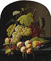 Severin Roesen - A Still Life with Grapes, Peaches and other Fruit on a Ledge.jpg