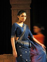 Sinhalese Girl Wearing A Traditional Kandyan Saree (Osaria)-1.jpg