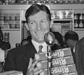 Sir Edmund Hillary, Selwyn Toogood, and an unidentified man, with give away Rinso products at the opening week of the Self Help store, Lambton Quay, Wellington, 1956 (cropped).jpg