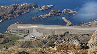 Sisimiut Airport - Sisimiut Airport is perched on the shore edge of Davis Strait. Runway and terminal seen from the Palasip Qaqqaa mountain.