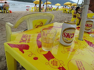 Skol - Skol cans and tables at the beach in Brazil