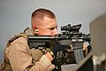 Special Reaction Team member, Provost Marshall's Office, Headquarters Battalion, Marine Corps Air Ground Combat Center, fires an M-4 service rifle during a training excercise.jpg