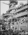 Spectators and photographers pick vantage spots on the deck of the USS MISSOURI in Tokyo Bay, to witness the formal... - NARA - 531312.tif
