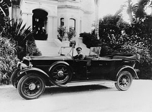 StateLibQld 1 85088 Crossley car used during the 1927 Royal Visit, waiting at Government House, Brisbane.jpg
