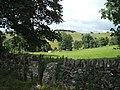 Stile, fields and deserted caravan - geograph.org.uk - 1413739.jpg