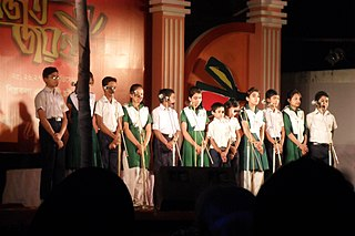 Bangladeshi schoolchildren performing on a stage