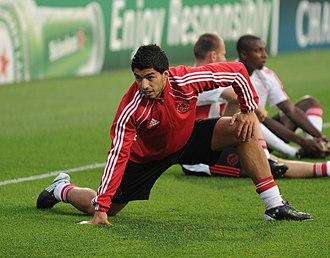Stretching - Football player Luis Suárez stretching prior to a match
