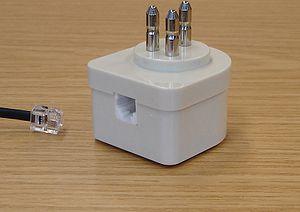 Tripolar plug - A tripolar plug-RJ11 adapter