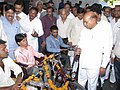 Thaawar Chand Gehlot interacting with the physically challenged persons, during the aids and assistive (Motorized Tricycle) distribution programme, at Ujjain.jpg