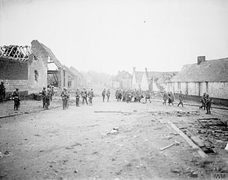 6th Infantry Division (United Kingdom) - Men of the 11th (Service) Battalion, Leicestershire Regiment, the divisional pioneers, with German prisoners in Ribecourt, France, less than two hours after the village was captured, 20 November 1917.