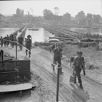 Allied advance from Paris to the Rhine - British infantry of the 1st Battalion, Hampshire Regiment crossing the Seine at Vernon, 28 August 1944.