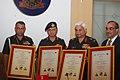 The DG (MP & PS), Lt. Gen. V.K. Chaturvedi , Dr. R. Krishna Kumar, Lt. Gen. S.P. Kochhar and Maj. Gen. S.S. Jog holding the MoU certificates.jpg