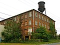 The Old Buggy Factory and Water Tower.JPG