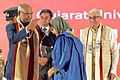 The President, Shri Ram Nath Kovind presenting the Medal to a student at the 66th Convocation of Gujarat University, at Ahmedabad, in Gujarat on January 21, 2018. The Governor of Gujarat, Shri O.P. Kohli is also seen.jpg