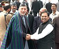 The President of Afghanistan, Mr. Hamid Karzai being received by the Minister of State for Personnel, Public Grievances & Pensions and Parliamentary Affairs, Shri Suresh Pachouri at Palam Airport in New Delhi on April 9, 2006.jpg