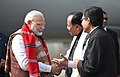 The Prime Minister, Shri Narendra Modi being welcomed on his arrival at Lilabari Airport, in Assam on February 15, 2018.jpg