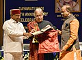 The Union Minister for Social Justice and Empowerment, Shri Thaawar Chand Gehlot presenting the Dayawati Modi Award for Art, Culture and Education to Sarod Player Ustad Amjad Ali Khan, in New Delhi.jpg