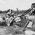 The crew of a twin-Browning light anti-aircraft gun keep watch for V-1 flying bombs, 19 June 1944. H39405.jpg