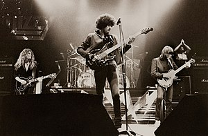 Thin Lizzy - Thin Lizzy at the Manchester Apollo, 1983.  L to R: John Sykes, Phil Lynott, Scott Gorham, and Darren Wharton; Brian Downey not visible.