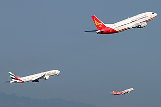 Takeoff - Three airliners taking off simultaneously (note similar pitch attitudes)