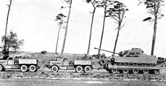 Tank transporter - The A39 Tortoise being towed on a trailer by two Diamond Ts during trials in BAOR, 1948