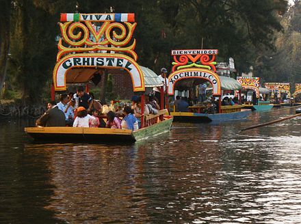 Trajineras in the canals of Xochimilco. Xochimilco and the historic center of Mexico City were declared a World Heritage Site in 1987. Trajinera.JPG