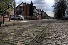Tramlines running along a cobbled road in Broughton.