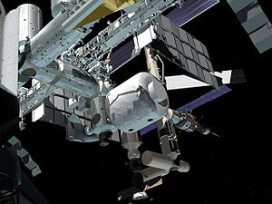 Inflatable space habitat - An artists rendering of the TransHab inflatable module berthed to the ISS.
