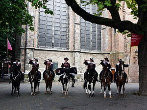 Festival Oude Muziek - A regiment of trumpeters on horseback perform in Domplein, the square in the ruins of St. Martin's Cathedral.