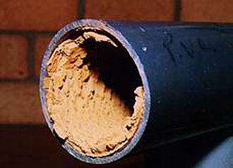 Water softening - Limescale in a PVC pipe