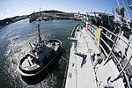 Tugboat Seminole (YT-805) and USS Cowpens (CG 63).jpg