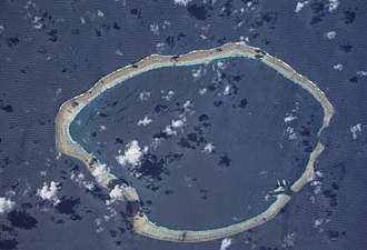 Carteret Islands - The Carteret Atoll seen from space. Rotate the image about 70 degrees clockwise and north will be at the top. Courtesy NASA.