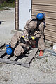 U.S. Army Sgt. Claude Williams, with the 73rd Civil Support Team, Kansas Army National Guard, checks the condition of fellow team member Sgt. John Tejada during a Vibrant Response 13 exercise at Muscatatuck 120807-A-PX072-030.jpg