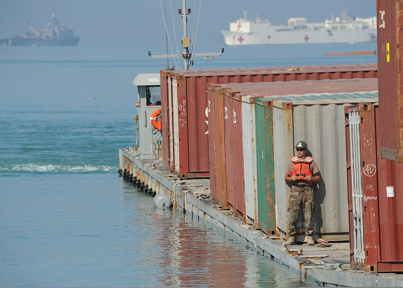 File:U.S. Navy Boatswain's Mate 1st Class Jason Fullenkamp, with Amphibious Construction Battalion 2, unloads a container via the Joint Logistics Over-the-Shore (JLOTS) system in Port-au-Prince, Haiti 100208-N-HX866-005.jpg