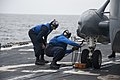 U.S. Navy Boatswain's Mate 3rd Class Travis Burke, right, and Boatswain's Mate Seaman Apprentice Kyle Kerley chock and chain a Royal Canadian Navy CH-124 Sea King helicopter to the flight deck of 130508-N-ZF573-088.jpg
