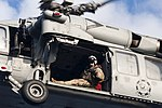 U.S. Navy Naval Aircrewman (Helicopter) 2nd Class Joseph Southern, assigned to Helicopter Sea Combat Squadron (HSC) 7, directs an MH-60S Seahawk helicopter as it lowers cargo to the flight deck of the aircraft 140307-N-ZG705-181.jpg