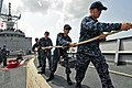 U.S. Sailors heave a line as guided missile frigate USS Simpson (FFG 56) arrives in Lagos, Nigeria, for a port visit supporting Africa Partnership Station 2012 120226-N-IZ292-143.jpg
