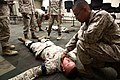 U. S. Marine Pfc. Manuel Rodriguez with Headquarters and Service Company, Combat Logistics Regiment 2, 2nd Marine Logistics Group, checks for a pulse on a simulated casualty as he undergo combat lifesaver 120904-M-KS710-009.jpg
