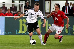 Toni Kroos - Kroos (left) battles Julian Baumgartlinger for the ball in a UEFA Euro 2012 qualifying match against Austria in Vienna (Ernst-Happel-Stadion).