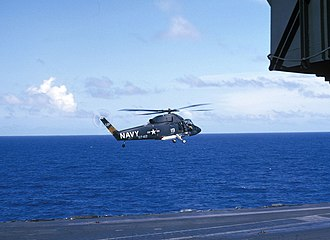 Kaman SH-2 Seasprite - A UH-2A on plane guard duty hovers over the USS Kitty Hawk in March 1966