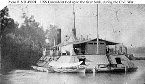 USS Carondelet (1861) - Stern view of USS Carondelet tied up to a river bank during the American Civil War.