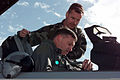 US Air Force Technical Sergeant Murray assists USAF Colonel Gary North with strapping into an F-16 Fighting Falcon aircraft prior to flying a training mission from Luke Air Force Base, Arizona 990311-F-NM830-009.jpg