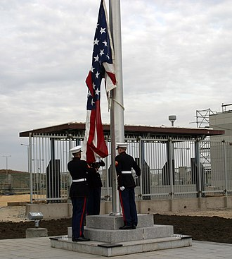 Marine Security Guard - Marine Security Guards raising the American flag at a new U.S. embassy in Astana, Kazakhstan in 2006.